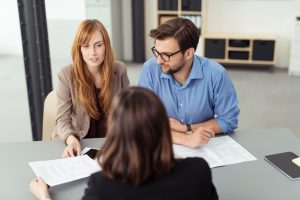 Couple discussing investments with a broker